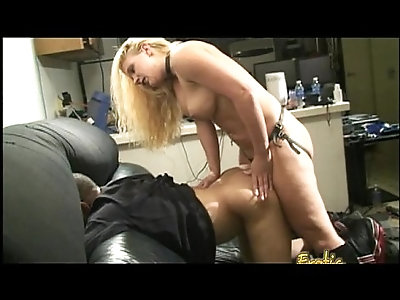 Raunchy blonde slut lets a horny stud cum on her latex boots