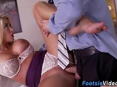 Busty office slut gives footjob
