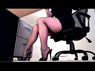 Sexy legs in pantyhose and peeptoe mule dangle