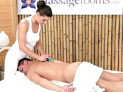 Masseuse rubs dick with giant tits and feet on massage table