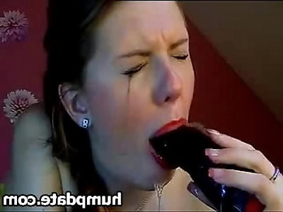 Beautiful babe deepthroating big black dildo